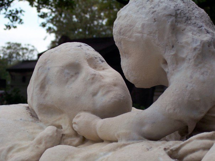 Daughter Says Farewell To Her Mother Forever At Père Lachaise Cemetery In Paris.