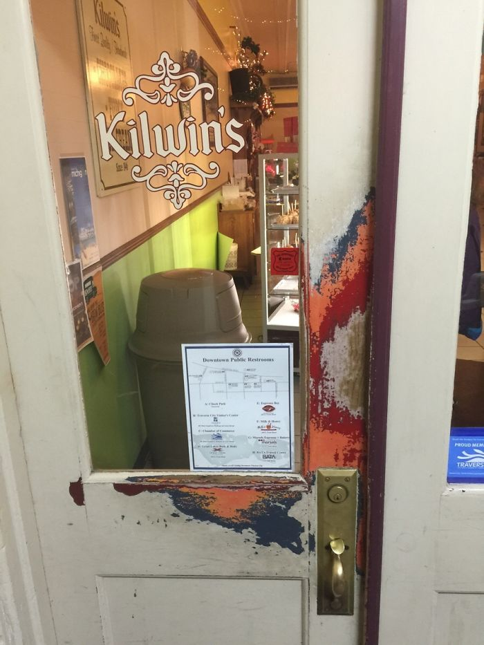 The Paint On This Chocolate Shop's Door Is Worn Away Perfectly To Reveal All Of Its Previous Colours