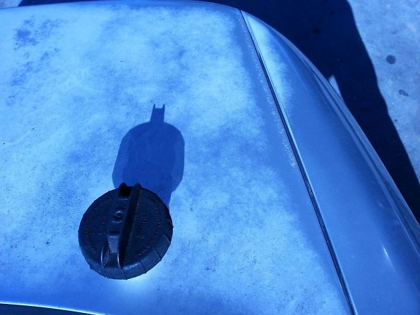 The Top To My Gas Tank Casts The Shadow Of Batman At The Right Angle