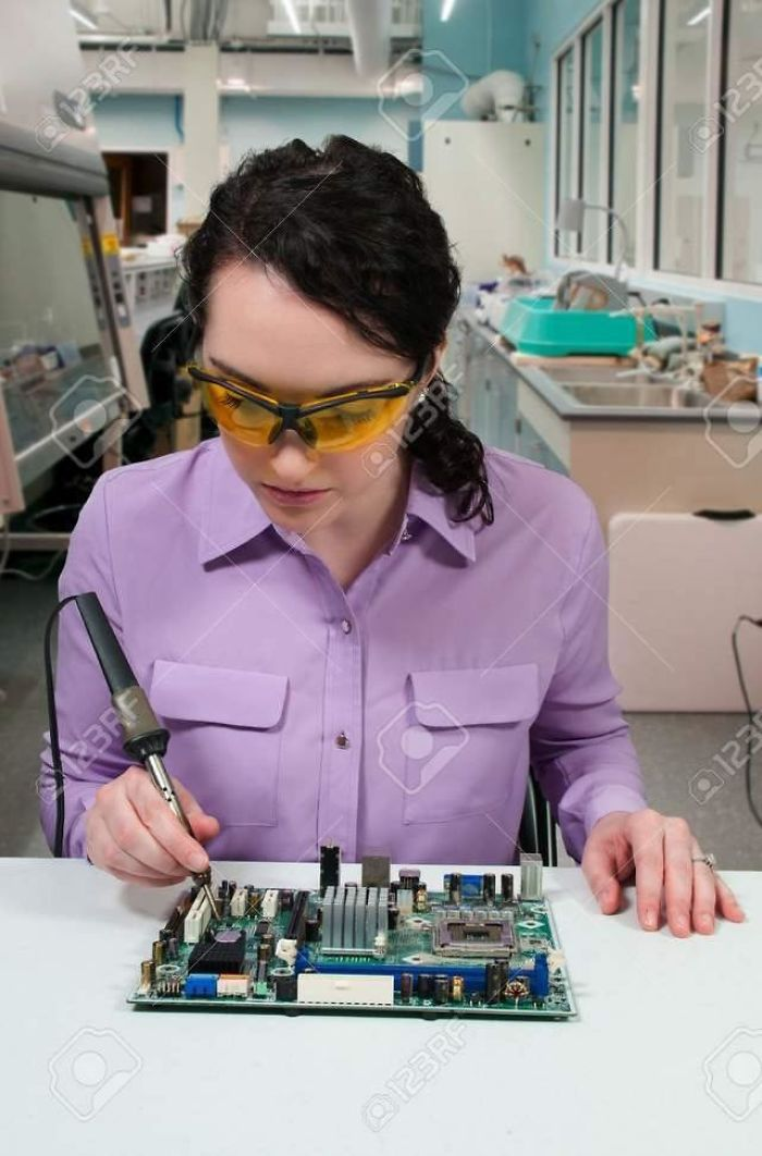 This Girl Soldering Her Hand In Stock Photo