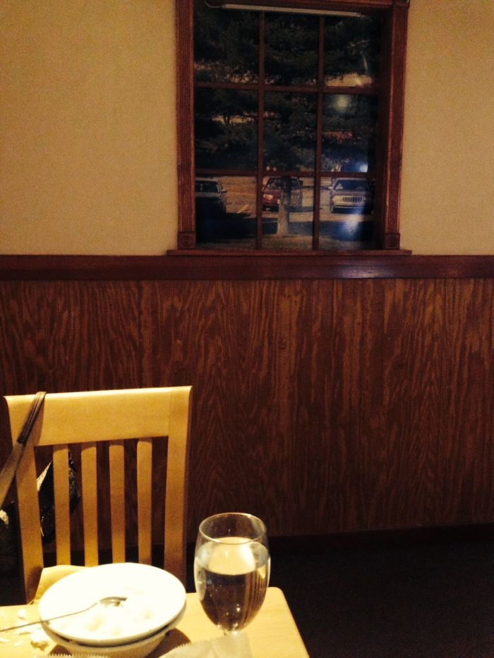 This Indian Restaurant Was In A Basement, But Wanted To Created The Sense That It Wasn't. They Created An Entire Wall Of Fake Windows Looking Out Into Pictures Of A Parking Lot