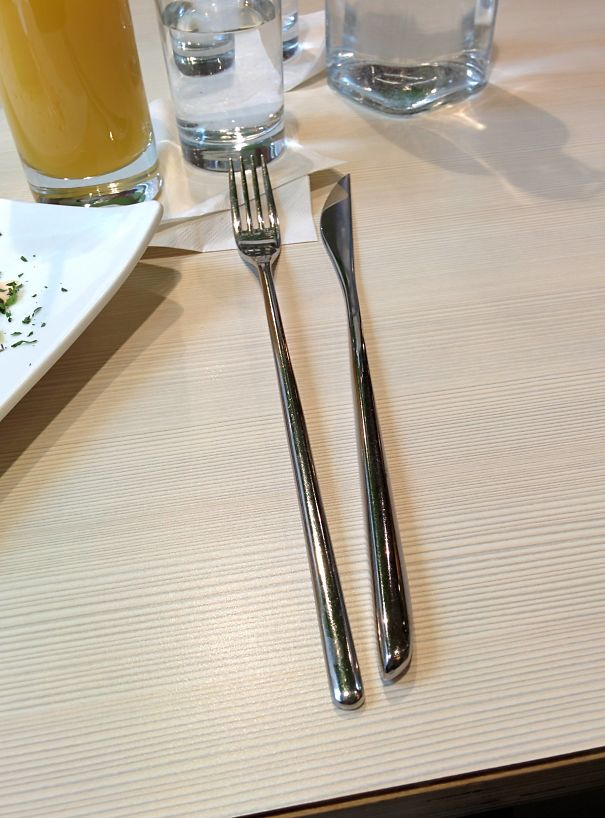 The Fork And Knife At This Restaurant Are Very Awkward