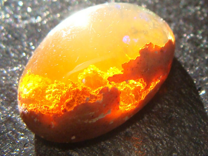 This Opal Looks Like A Sunset In The Clouds