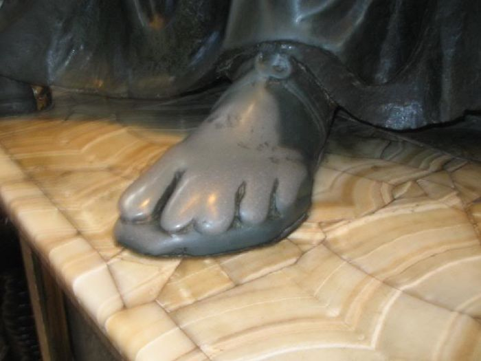 St Peter's Foot In St Peters Cathedral In Rome. Worn Out By Centuries Of Devotion
