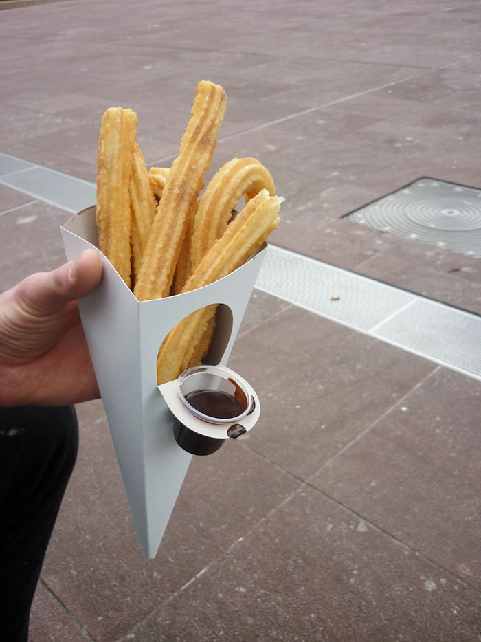 Churros With A Container For Chocolate Sauce