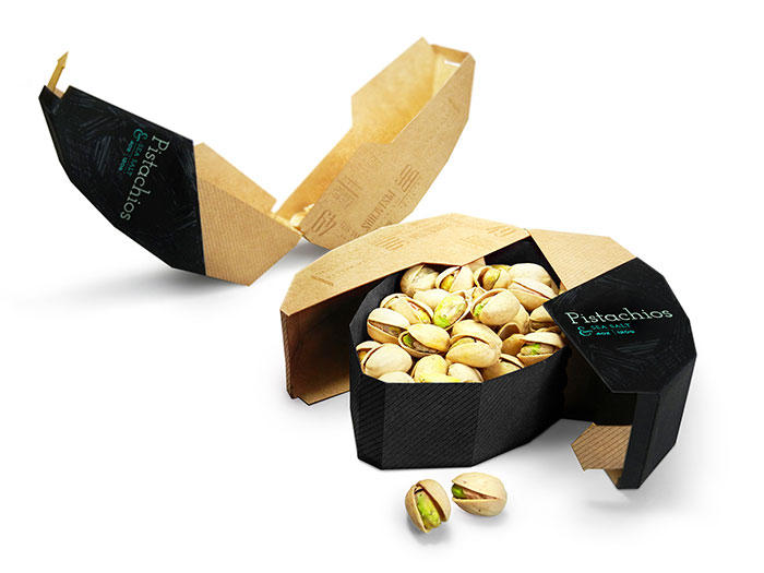Packaging For Pistachio Nuts. Inside Tray Holds Pistachios But The Outer Part Separates And Becomes A Tray For The Shells