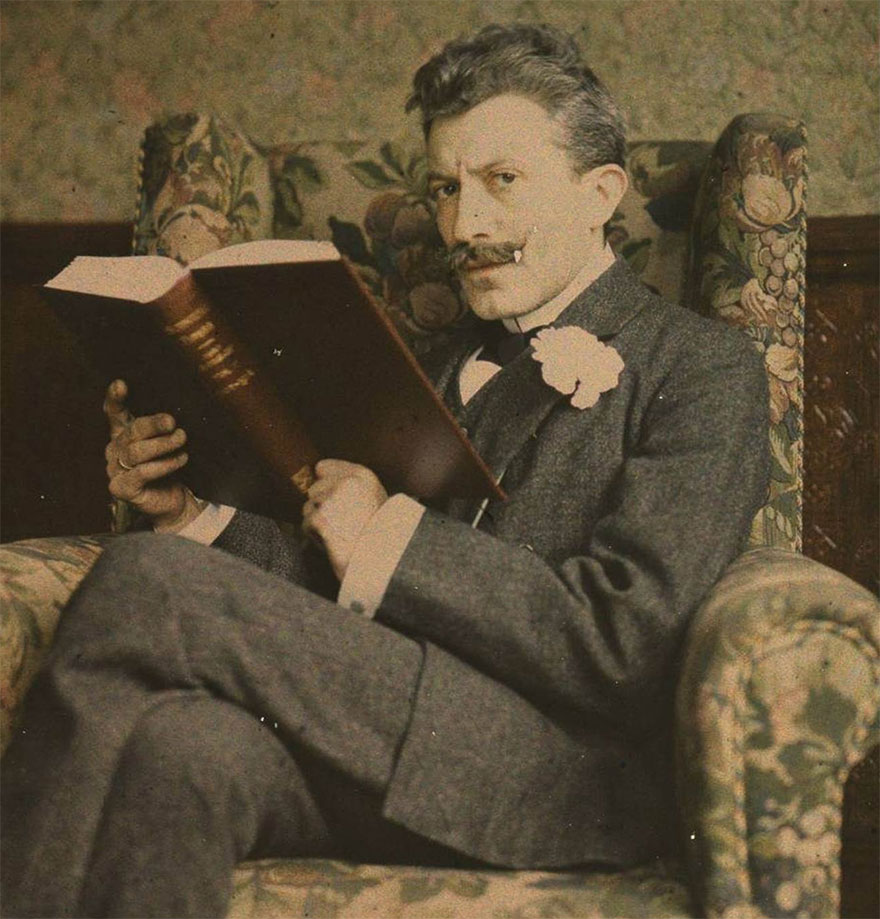 Man With Book Sitting In Chair, 1915