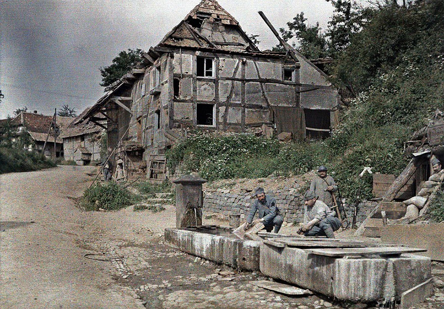 Two French Soldiers Assigned To A Telephone Station Are Washing Their Laundry In A Trough Of A Fountain, While Three Others Are Watching, 18th June 1917
