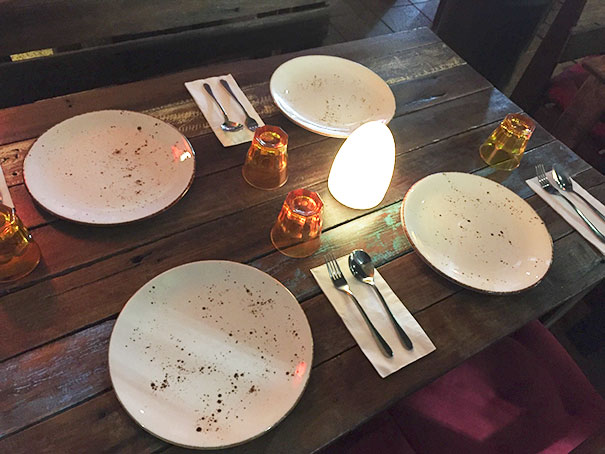 The Design Of These Plates At A Restaurant Makes It Look Like They Are Dirty