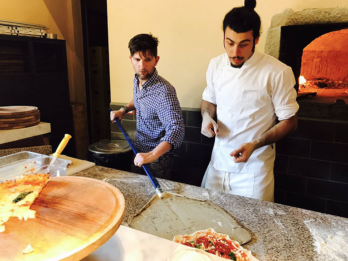 """Parks & Rec"" Star Adam Scott Hilariously Fails At Pizza Class In Italy, Chef Saves Him In The Most Brilliant Way"