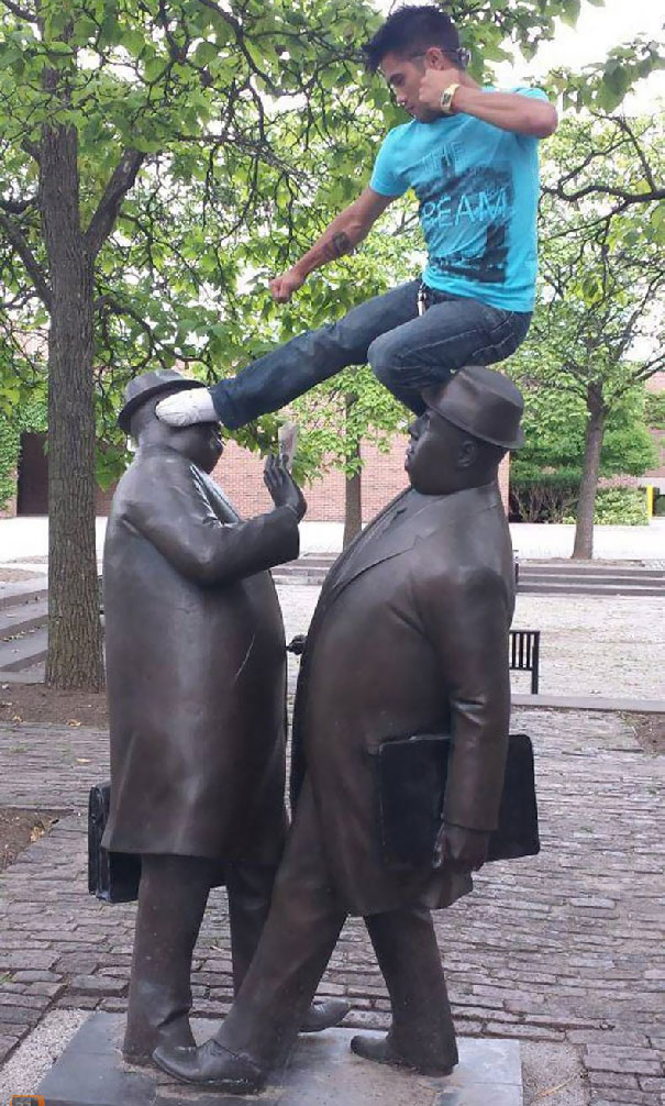 People Playing With Statues