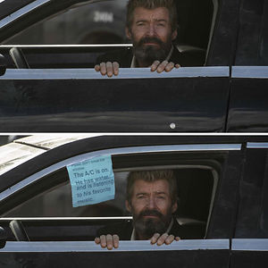 Hugh Jackman Looking Out Of A Car Window