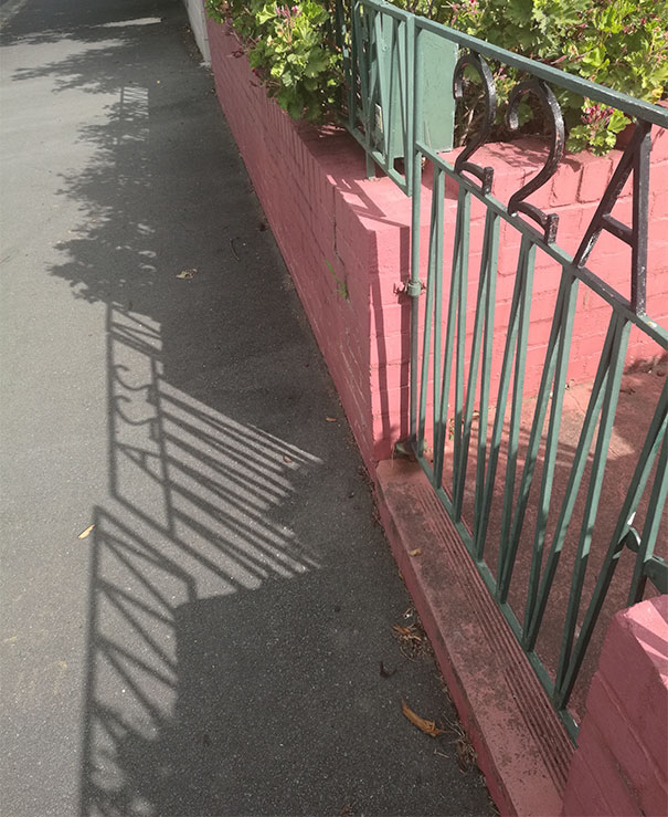 The Shadow Of This Gate Looks Like It Says Ass