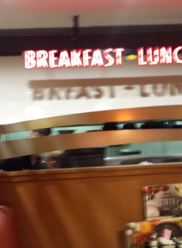 "The Shadow Of This Breakfast Sign Says ""Breast"""