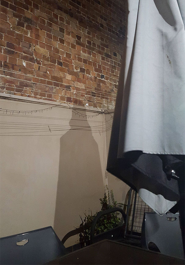 My Mates Backyard Umbrella Casts A Darth Vader Shadow