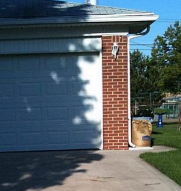 This Shadow On A Garage Door Looks Like Rambo