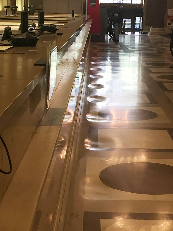The Marble Floor Of This Bank Has Been Worn Down From Years Of People Standing