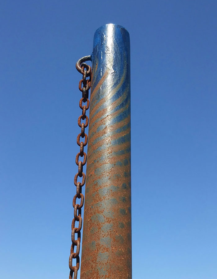 The Wear Marks On This Tetherball Pole