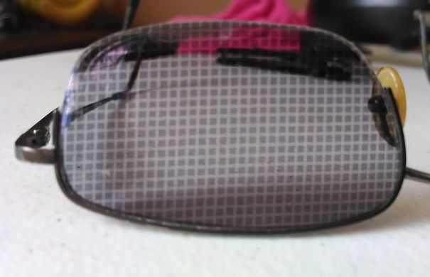 I Left My Transition-Lensed Glasses Next To A Window Screen And The Sun Left A Checkerboard Pattern On The Lens