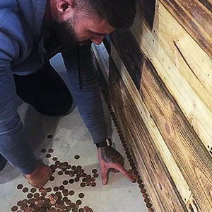 When This Barber Was Quoted £1000 For The New Shop Floor He Decided To Cover It With 70,000 Pennies Instead