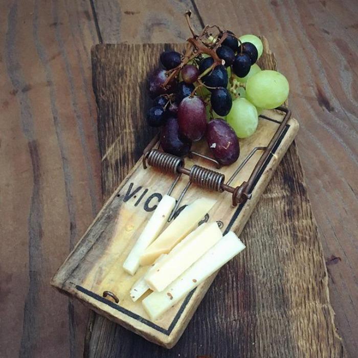 Half-Eaten Cheese And Grapes At Noa Restaurant