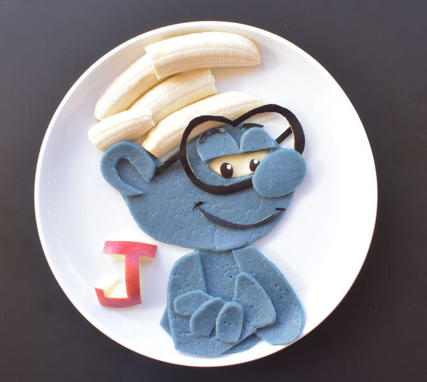 Brainy Smurf From The Smurfs Movie - Spelt Pancakes (dyed Using Blue Matcha) Served With Banana And Apple