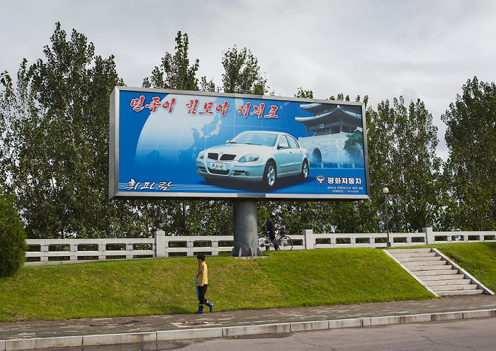 Ironically, The Only Advertising Billboards You Can See In Pyongyang Are About… Cars!