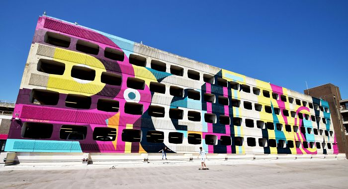 Street Artist Transforms 60s Carpark With Giant, Candy-Striped Supergraphic Artwork