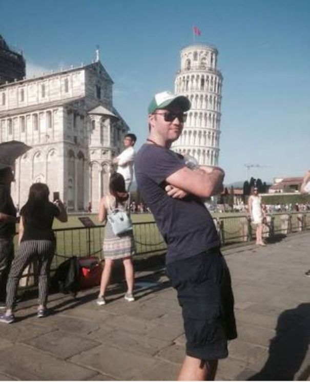 Guy Trolling Other Tourists Near The Pisa Tower