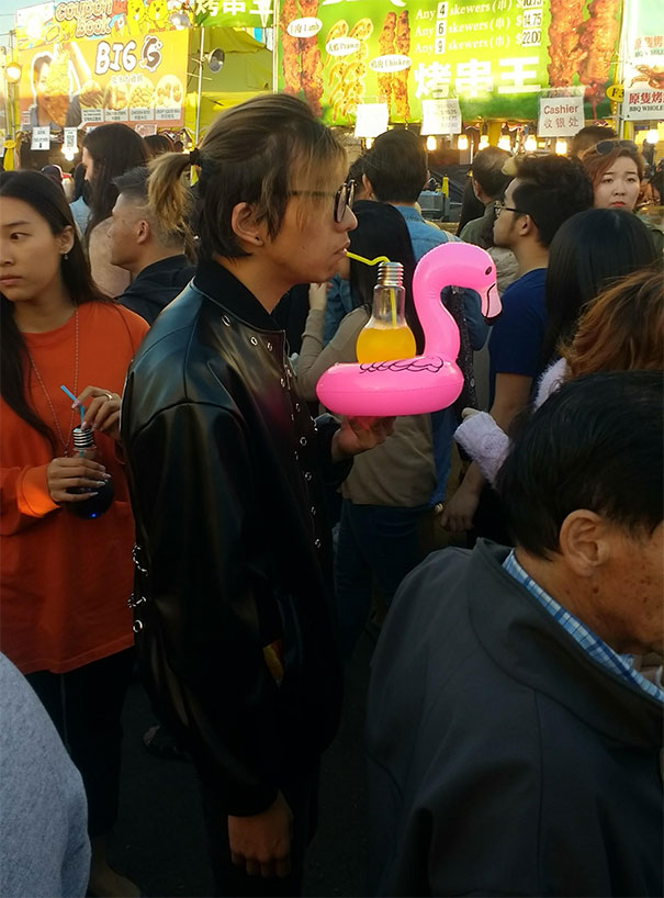 Drink Served In A Lightbulb On A Flamingo Inner Tube