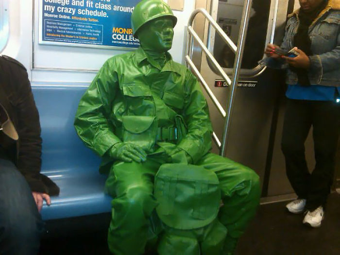 On The NYC Subway, Handing Out Little Green Army Men To Kids