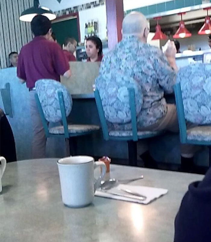 This Guy's Shirt Matches The Chair