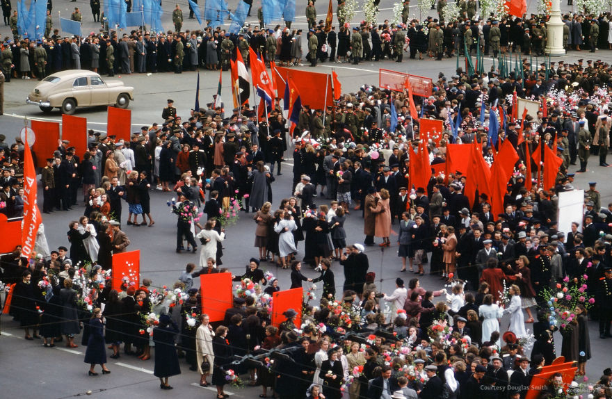 Flowers, Dancing, And North Korean Flags At A Parade In Moscow