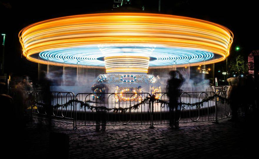 Long Exposure Shot Of A Carousel At Night