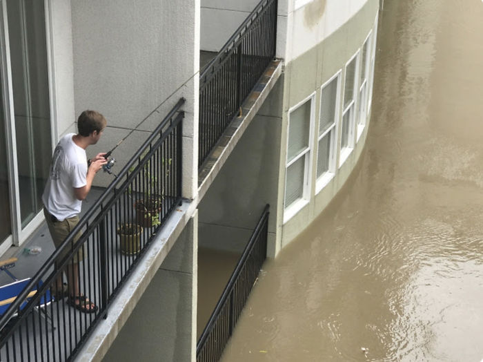 My Friend Fishing From His Balcony In Houston