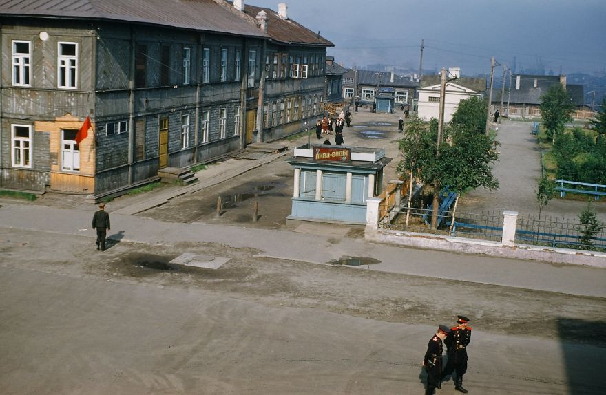 Russian Officials Are Photographed From A Window Above The Street In Murmansk