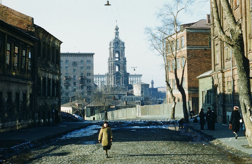 A Child Walks Through A Run-Down Street In Moscow Near The Moskva River