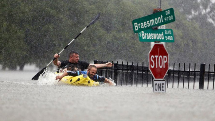 Two Kayakers Try To Beat The Current Pushing Them Down An Overflowing Brays Bayou From Tropical Storm Harvey In Houston