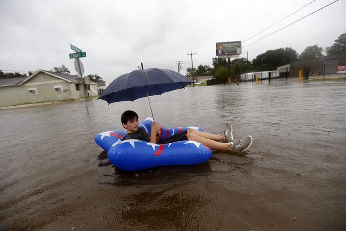 Julius Verret, 14, Floats In Street Flooding In Lake Charles