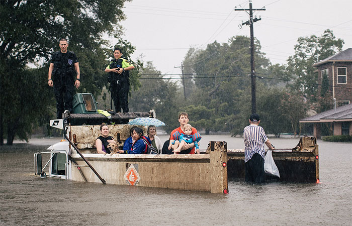Rescue Workers And Civilians Waited For Emergency Crews In The Meyerland Area Of Houston