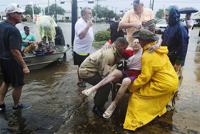 Neighbors Used Their Personal Boats To Rescue Jane Rhodes In Friendswood, Texas