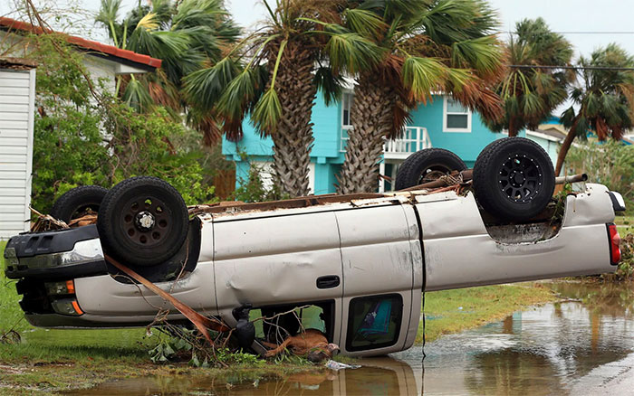 A Dead Dog Lies Out Of The Passenger Window Of An Overturned Pickup Truck After Hurricane Harvey Landed In The Coast Bend Area In Port Aransa