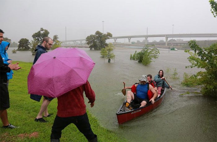 Area Residents Use A Kayak To Rescue Motorists Stranded On Interstate Highway 45 In Houston