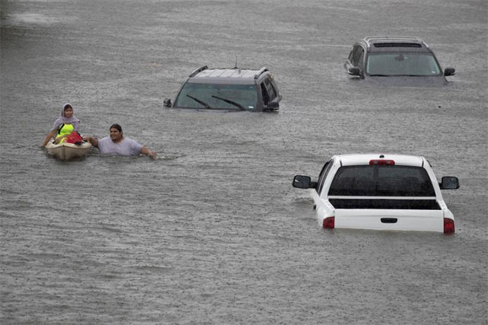 Jesus Rodriguez Rescues Gloria Garcia After Rain Flooded Pearland, In The Outskirts Of Houston