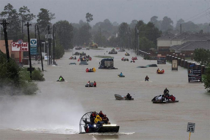 Residents Use Boats To Evacuate Flood Waters Along Tidwell Road In East Houston, Texas