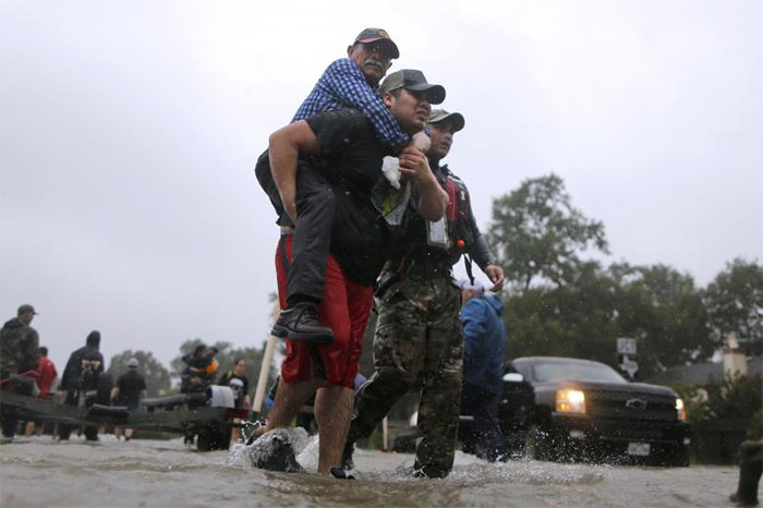 An Elderly Man Is Carried After Being Rescued In East Houston, Texas