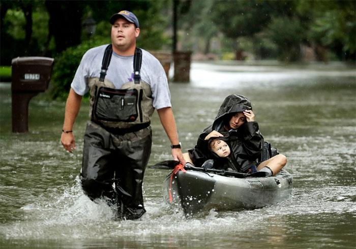 People Evacuate A Neighborhood In West Huston