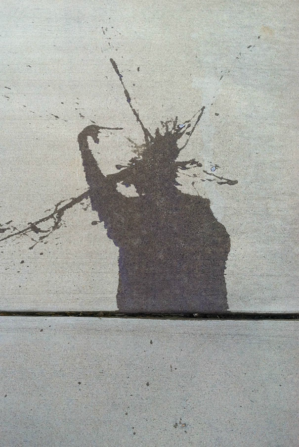 This Water Splash On This Driveway Looks Like The Statue Of Liberty Pointing At Her Head