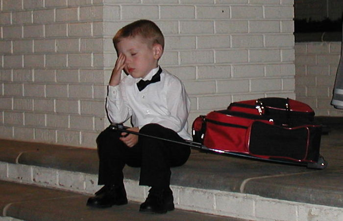 My Little Cousin After An All-Day Wedding Affair (The Suitcase Contains His Travel Toys)