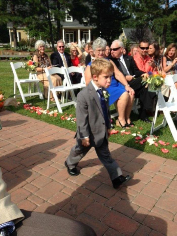 This Kid Really Doesn't Like Weddings